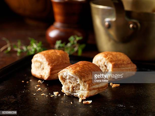 Christmas snack of outdoor bred mini sausage rolls and thyme leaves
