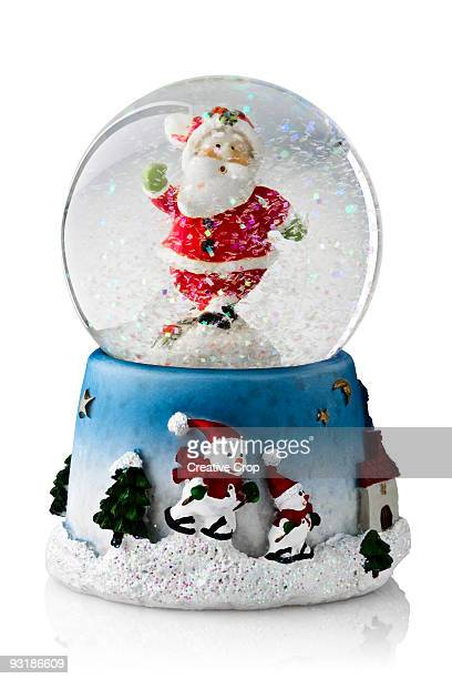 Christmas snow globe containing Father Christmas