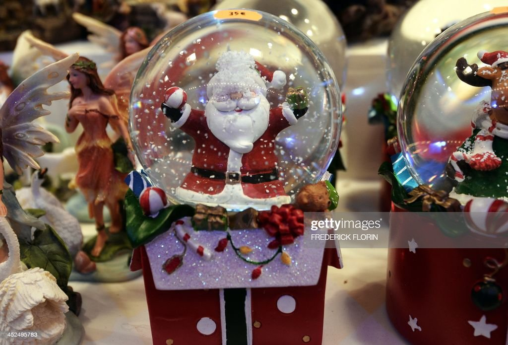 Christmas snowglobes are displayed in Strasbourg, eastern France, on November 29, 2013 on the opening day of the city's Christmas market, the largest and one of the oldest Christmas markets in France. With over 300 market chalets, Strasbourg attracts over two million visitors during the Christmas season.
