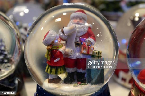 Christmas snowglobes for sale are displayed in Strasbourg eastern France on November 28 on the opening day of the city's Christmas market the largest...
