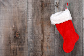 closeup of a Christmas stocking hanging on old barn board
