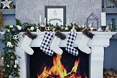 Christmas socks hanging on a fireplace
