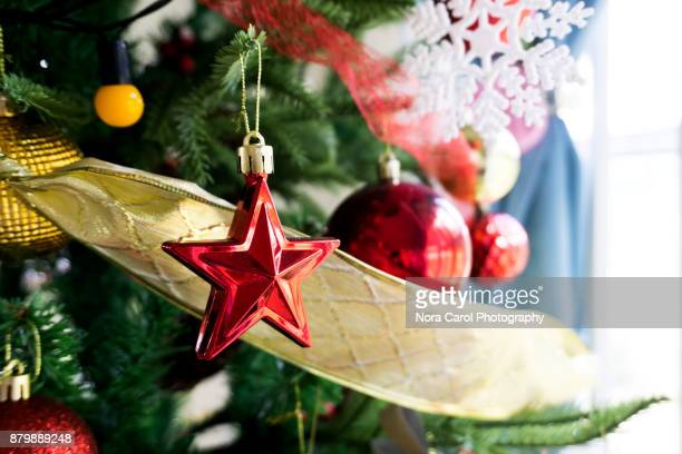 Christmas Star Hanging on Christmas Tree