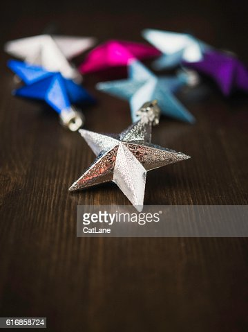 Christmas star ornaments on rustic wood table top : Stock Photo
