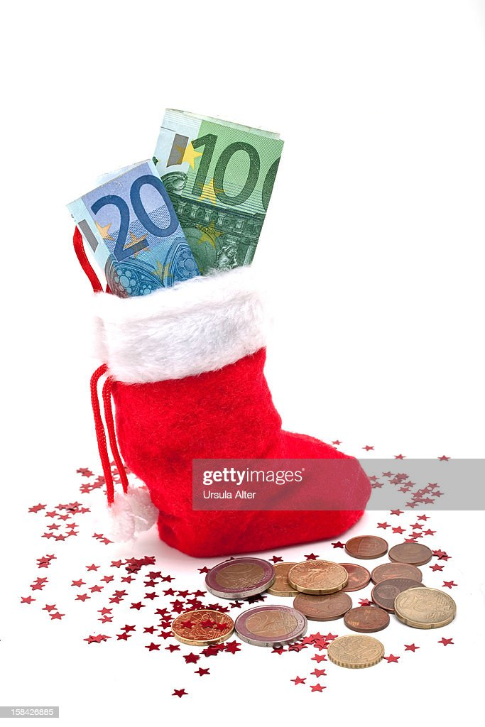 A christmas stocking filled with euro currency : Stock Photo