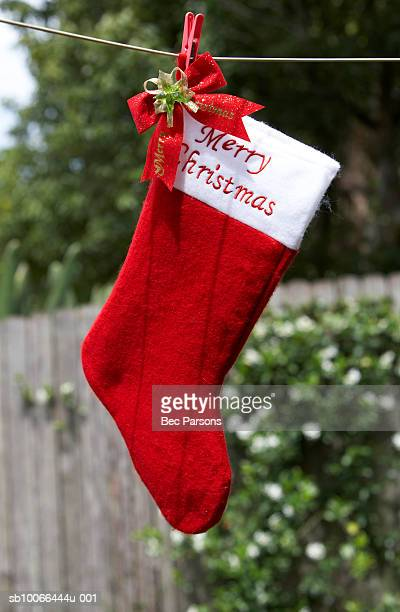 Christmas stocking hanging on clothesline, outdoors