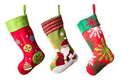 Three Christmas stockings isolated on white background