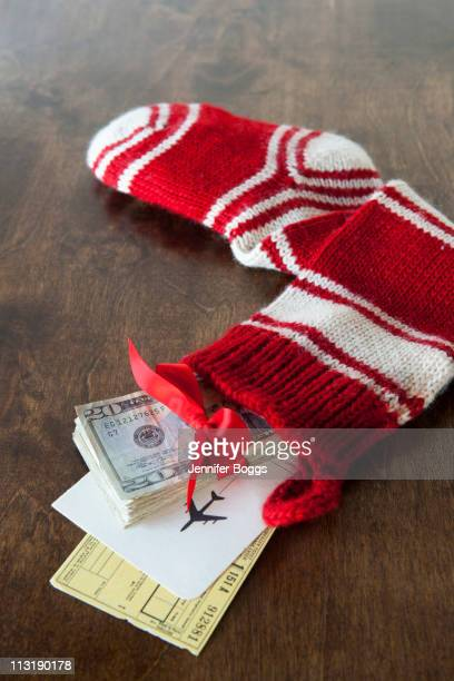 Christmas stocking with airline tickets and cash