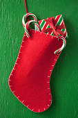 Christmas stocking with gift and candy canes