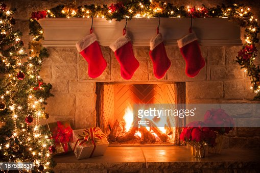 Christmas stockings, fireplace, tree, and decorations