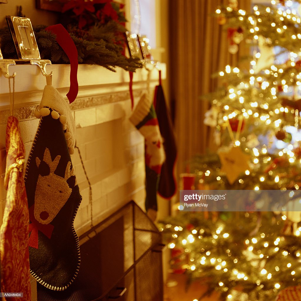 Christmas stockings hanging from fireplace mantel : Stock Photo