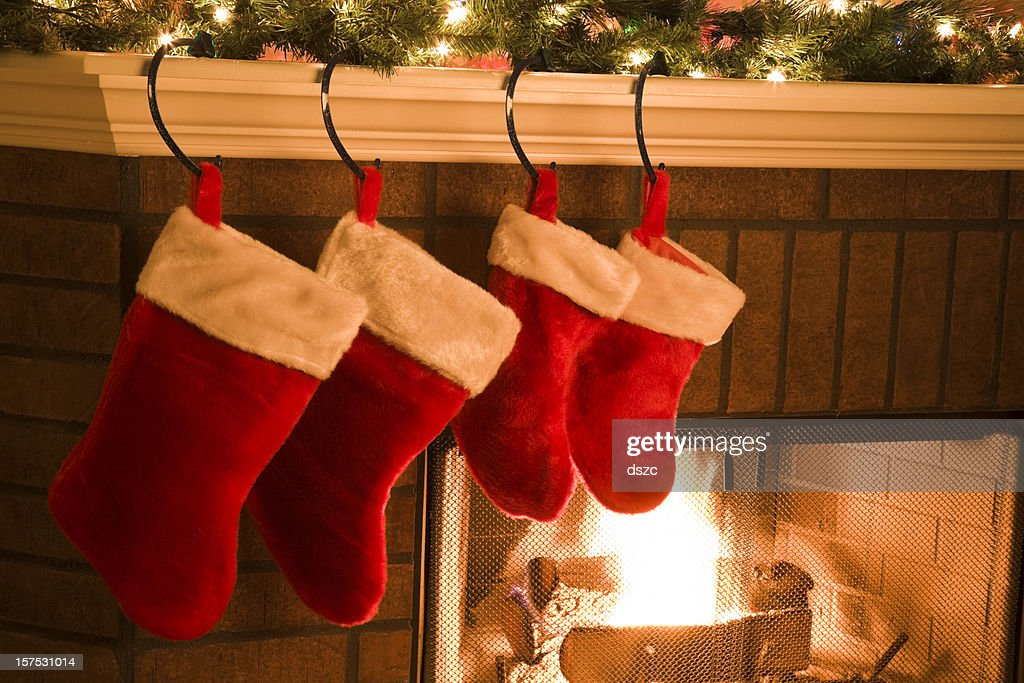 Christmas stockings hung on mantel by holiday season