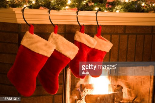 Christmas Stockings hung on Mantel by Holiday Season Fireplace