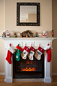 Christmas stockings hung over the fireplace.  Two red stockings for mom and dad and four stocking in the middle for the kids.