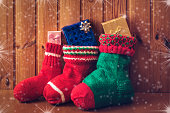 Christmas stockings on wooden background. Vintage style