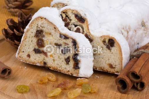 Christmas stollen with raisins and spices : Stock Photo
