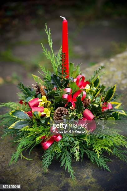 Christmas table decoration with red candle