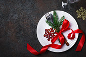 Christmas table setting with christmas decorations on a dark background