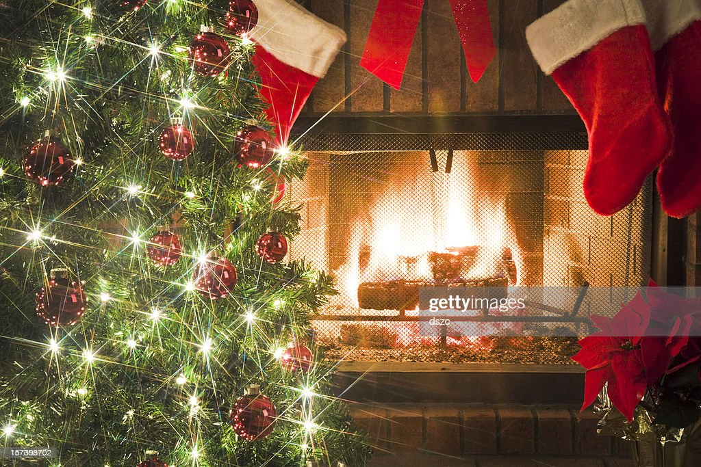 Christmas Tree And Decor Around The Fireplace With Blazing