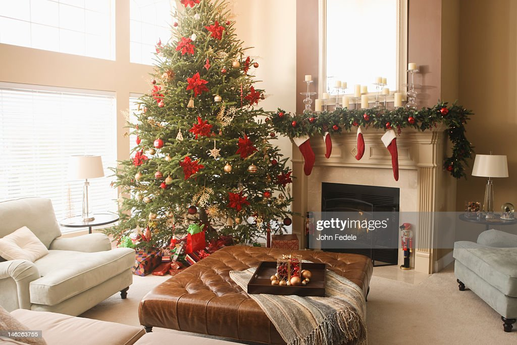 Christmas tree and decorations in living room stock photo Christmas decoration in living room