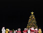 Christmas tree and figurines, front view, black background
