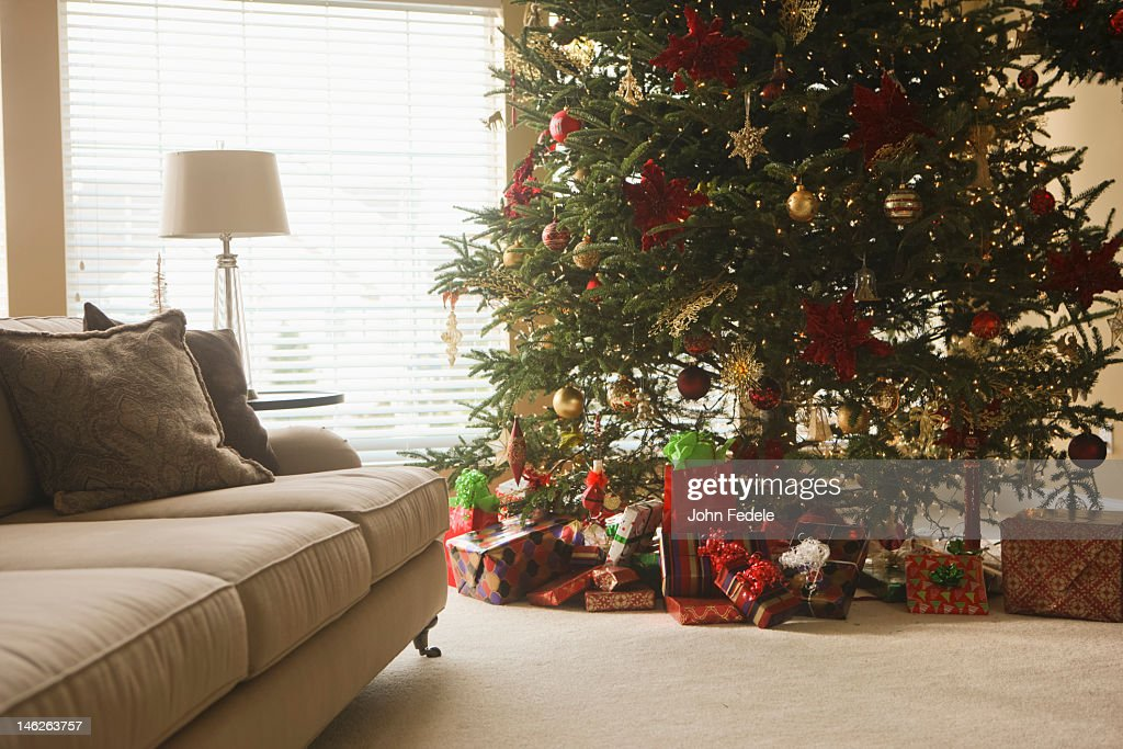 Christmas tree and gifts in living room : Stock Photo