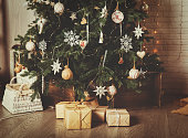 Christmas tree and presents in decorated living room, Christmas and New Year concept