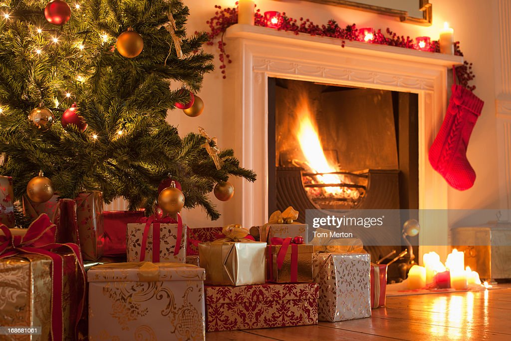Christmas tree and stocking near fireplace : Stock Photo
