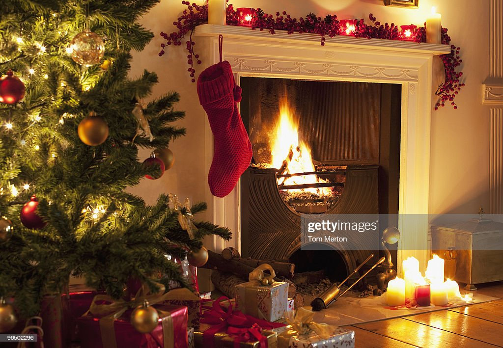 Christmas tree and stocking near fireplace : Stock Photo