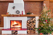 Christmas time at home by the cosy fireplace