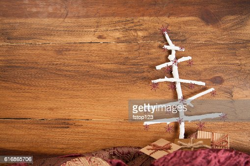 Christmas tree craft background in wood with gifts. : Stock Photo