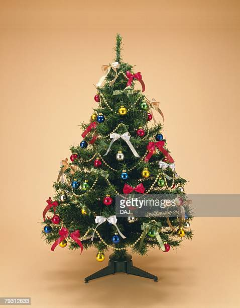 Christmas tree decorated with ornaments, front view