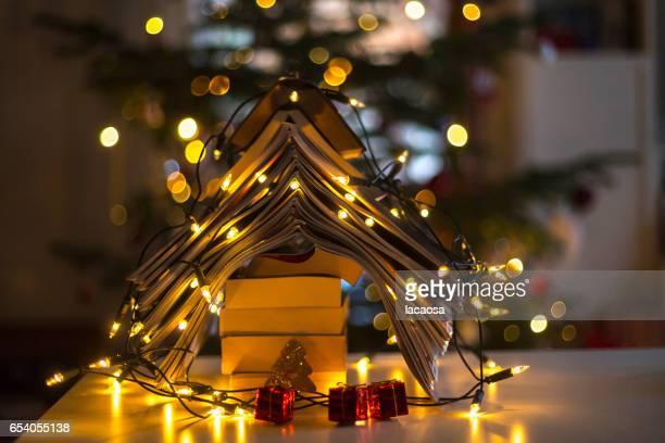 christmas tree formed with books and christmas lights
