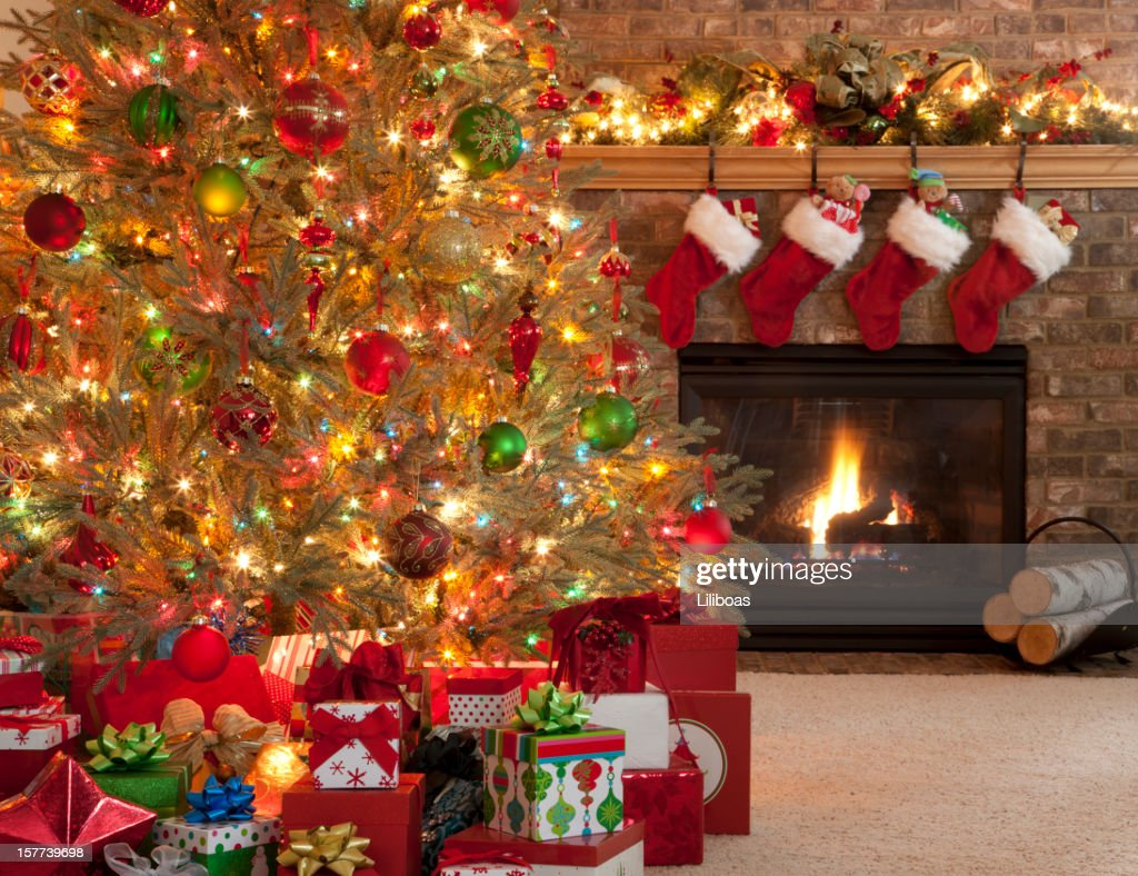 christmas tree in front of fireplace stock photo getty images