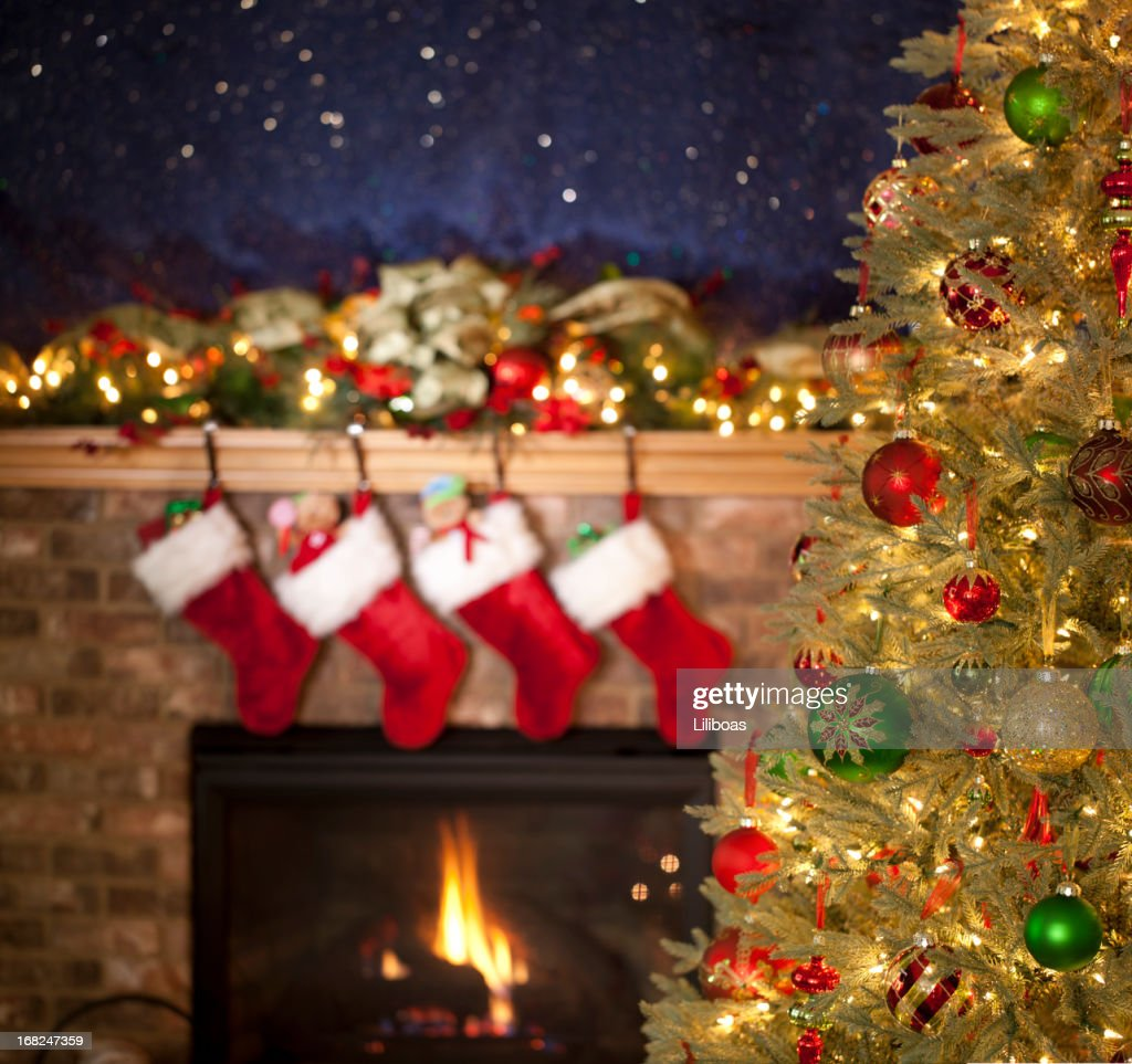 christmas tree in front of the fireplace stock photo getty images