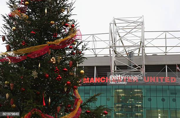 Christmas tree is displayed in front of the stadium prior to the Barclays Premier League match between Manchester United and Norwich City at Old...