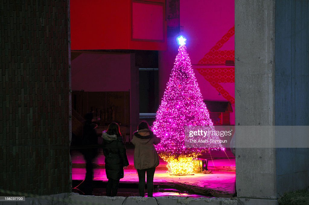 A Christmas tree is illuminated at ruined Okawa Elementary School to commemorate the victims on December 11, 2012 in Ishinomaki, Miyagi, Japan. Okawa Elementary School, where 70 out of 108 pupils were killed by the earthquake triggered tsunami, the searching work continues.