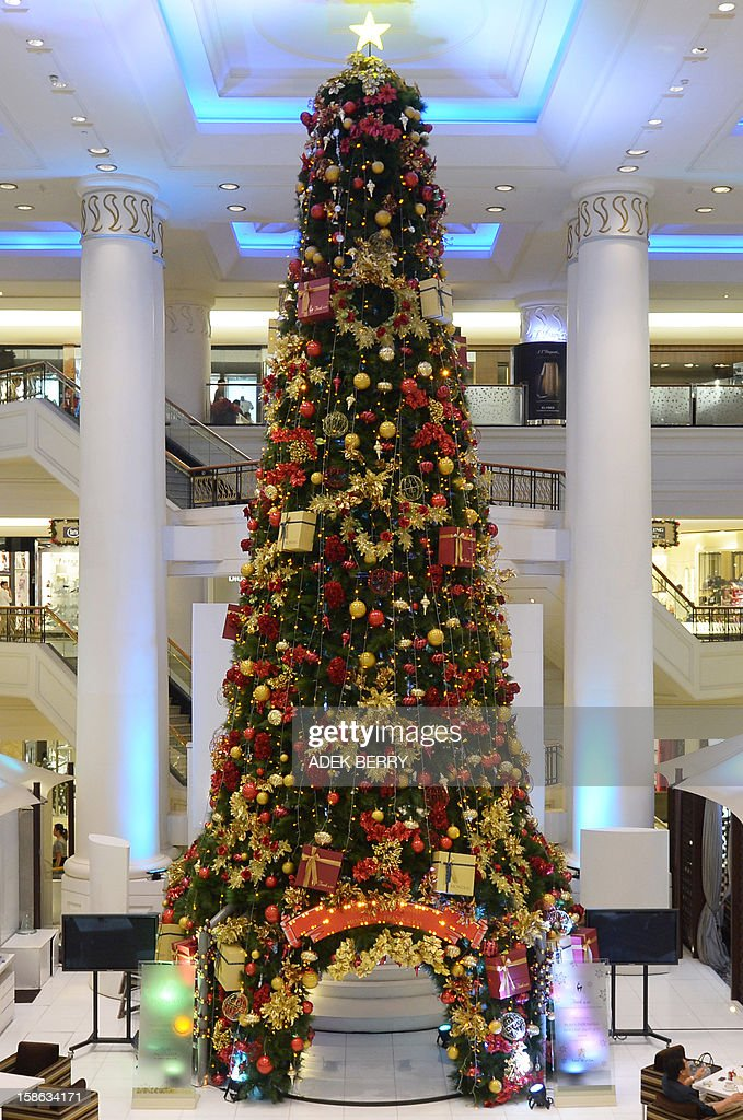A Christmas tree is placed near a restaurant inside a shopping mall in Jakarta on December 22, 2012. Many shopping malls and business centres in Indonesia, the largest Muslim-majority nation in the world, are decorated with Christmas ornaments to welcome Christmas and New Years. AFP PHOTO / ADEK BERRY