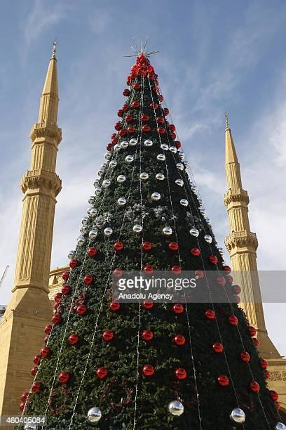 Christmas tree is seen near the Mohammad AlAmin Mosque in in Byblos Lebanon on December 10 2014 Sculptures amusement parks Christmas ornaments trees...