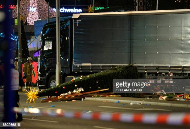 A christmas tree lies next to a truck that crashed into a christmas market at Gedächtniskirche church in Berlin on December 19 2016 killing at least...
