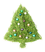 Christmas tree made of spruce needles and decorated with beads on isolated white