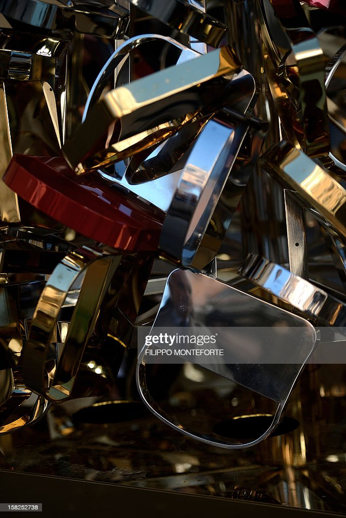 A Christmas tree made with metal models of famous Fendi bags is setup infront of Rome's Fendi shop on December 12, 2012 in Rom. AFP PHOTO/ Filippo MONTEFORTE