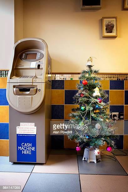 Christmas tree next to cash machine
