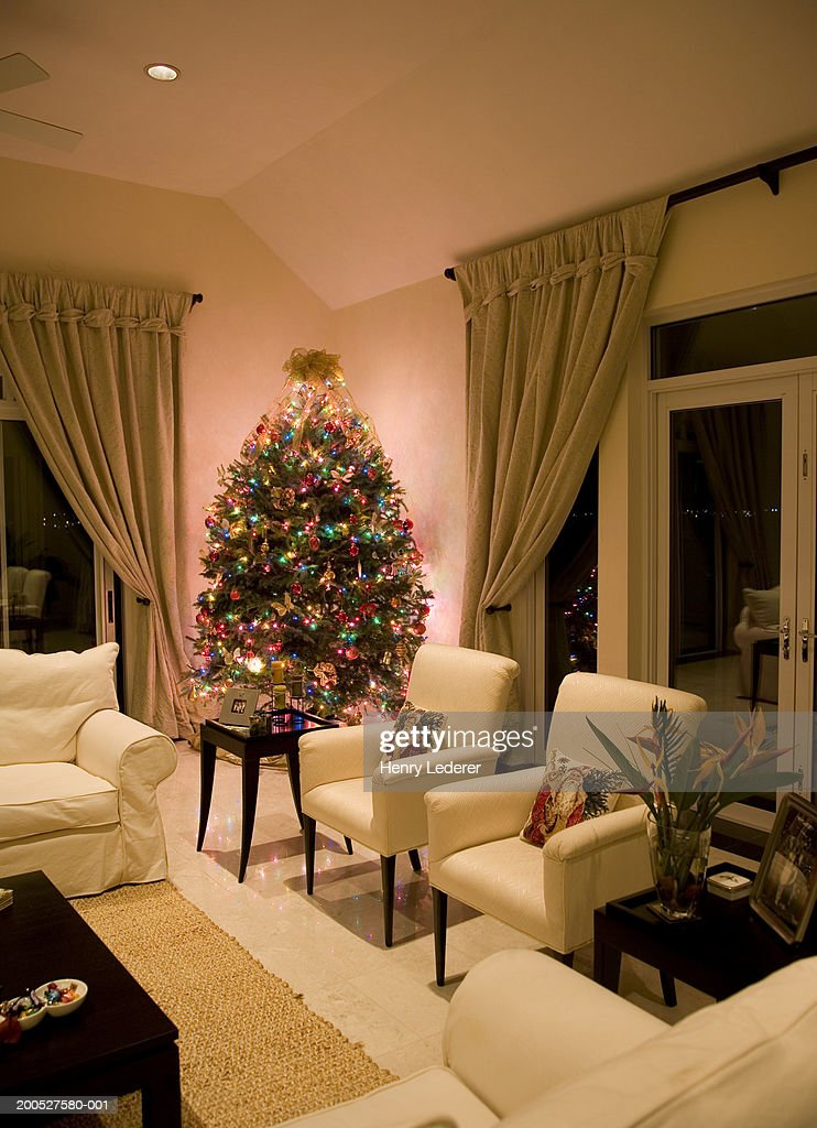 Christmas Tree On Table In Living Room Stock Photo Getty
