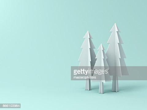 Arbol De Navidad O Pinos Sobre Fondo De Color Pastel Verde Claro