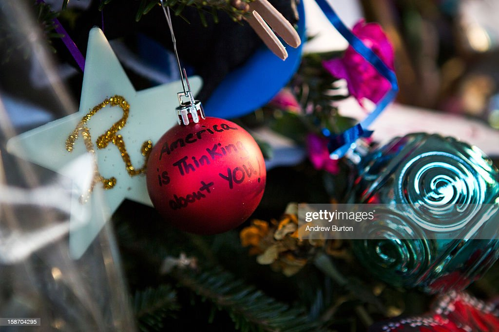 A Christmas tree ornament reasds 'America is Thinking about you!' at a memorial for those killed in the school shooting at Sandy Hook Elementary School on December 24, 2012 in Newtown, Connecticut. Donations and letters are pouring in from across the country as the town tries to recover from the massacre.