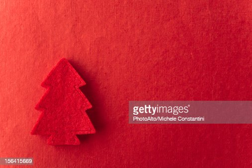 Christmas tree shape on red background