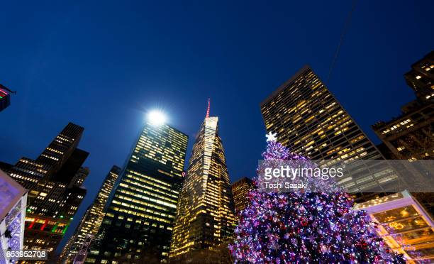 Christmas tree stands among the Midtown Manhattan Skyscrapers in the night at Bryant Park New York on Dec. 21 2016.