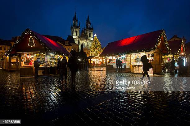 Christmas tree stands as people visit the Christmas market at the Old Town Square on December 1 2014 in Prague Czech Republic Christmas markets...