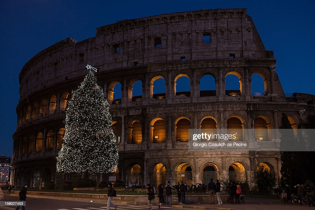 A Christmas tree stands illuminated in front of the Coliseum on December 9, 2012 in Rome, Italy.